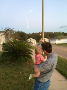 Nicholas and Daddy watching a rocket launch.
